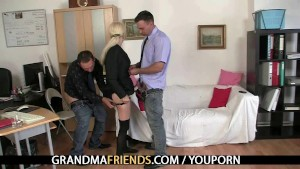 Old blonde enjoys two cocks