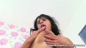 British milf Raven strips off