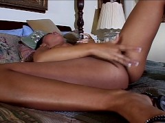 Eva Angelina fingers her pussy and sucks her own nipples