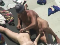 Naked wife plays with husband's cock on the beach