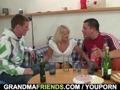 Blonde grandma takes two big cocks at...