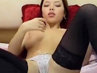 Hot Asian chick playing with her self