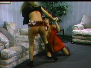 Two hot girls wrestle in the living room
