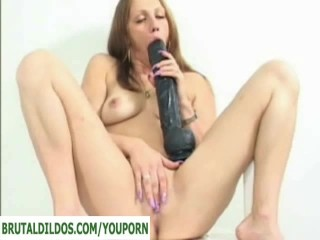 Amateur taking dildo extremely deep...