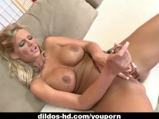 Phoenix Marie fucks herself with a glass dildo...