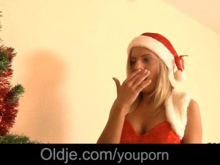 Teen in sexy x mas dress tempts to...
