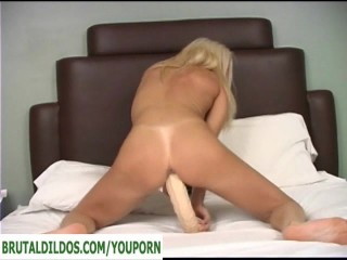 Blonde mature with big dildo