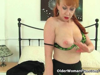 British milf Red strips off and finger fucks